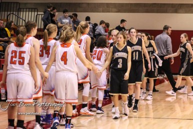 Members of the LaCrosse Lady Leopards and Otis-Bison Lady Cougars shake hands following the game. The Otis-Bison Lady Cougars defeated the LaCrosse Lady Leopards by a score of 29 to 23 in the Semi-Final of the 2018 Hoisington Winter Jam at the Hoisington Activity Center in Hoisington, Kansas on January 19, 2018. (Photo: Joey Bahr, www.joeybahr.com)