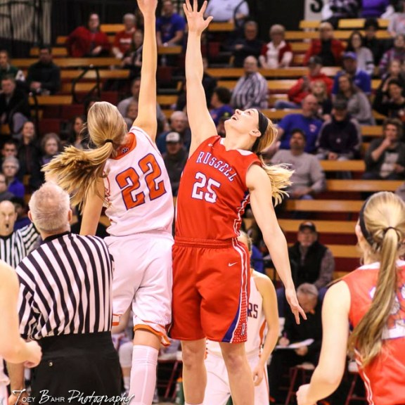 Otis-Bison Lady Cougar #22 Maddie Wiltse and Russell Lady Bronco #25 Jaclyn Schulte jump for the opening tip off. The Russell Lady Broncos defeated the Otis-Bison Lady Cougars by a score of 54 to 34 in the Girls Championship game of the 2018 Hoisington Winter Jam at the Hoisington Activity Center in Hoisington, Kansas on January 20, 2018. (Photo: Joey Bahr, www.joeybahr.com)