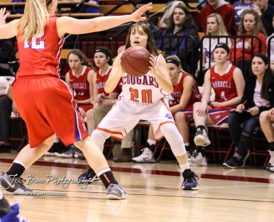 Otis-Bison Lady Cougar #20 Sheridan Ewy looks for an open teammate to pass the ball to. The Russell Lady Broncos defeated the Otis-Bison Lady Cougars by a score of 54 to 34 in the Girls Championship game of the 2018 Hoisington Winter Jam at the Hoisington Activity Center in Hoisington, Kansas on January 20, 2018. (Photo: Joey Bahr, www.joeybahr.com)