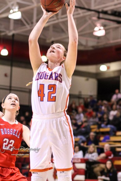 Otis-Bison Lady Cougar #42 Cora Anderson goes up for a layup. The Russell Lady Broncos defeated the Otis-Bison Lady Cougars by a score of 54 to 34 in the Girls Championship game of the 2018 Hoisington Winter Jam at the Hoisington Activity Center in Hoisington, Kansas on January 20, 2018. (Photo: Joey Bahr, www.joeybahr.com)