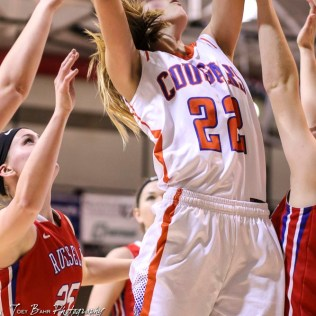 Otis-Bison Lady Cougar #22 Maddie Wiltse goes for a layup. The Russell Lady Broncos defeated the Otis-Bison Lady Cougars by a score of 54 to 34 in the Girls Championship game of the 2018 Hoisington Winter Jam at the Hoisington Activity Center in Hoisington, Kansas on January 20, 2018. (Photo: Joey Bahr, www.joeybahr.com)