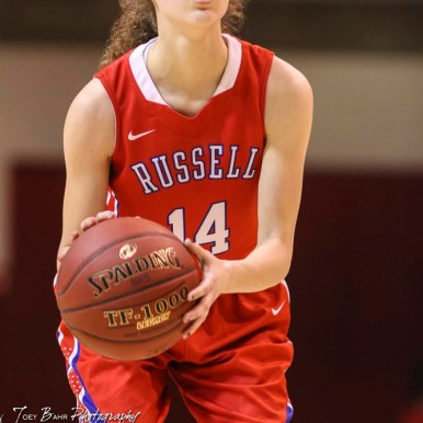 Russell Lady Bronco #14 Megan Peeler shoots a free throw attempt. The Russell Lady Broncos defeated the Otis-Bison Lady Cougars by a score of 54 to 34 in the Girls Championship game of the 2018 Hoisington Winter Jam at the Hoisington Activity Center in Hoisington, Kansas on January 20, 2018. (Photo: Joey Bahr, www.joeybahr.com)