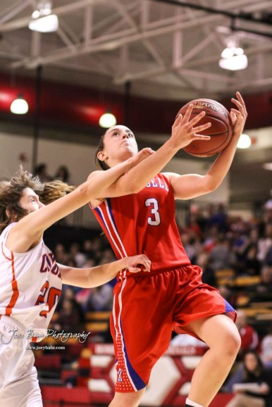 Russell Lady Bronco #3 Tiffany Dortland goes for a layup as Otis-Bison Lady Cougar #20 Sheridan Ewy makes contact with her arm. The Russell Lady Broncos defeated the Otis-Bison Lady Cougars by a score of 54 to 34 in the Girls Championship game of the 2018 Hoisington Winter Jam at the Hoisington Activity Center in Hoisington, Kansas on January 20, 2018. (Photo: Joey Bahr, www.joeybahr.com)