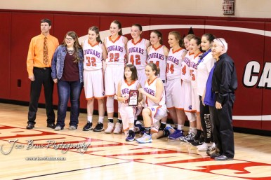 The Otis-Bison Lady Cougars pose with the second place trophy following the conclusion of the game. The Russell Lady Broncos defeated the Otis-Bison Lady Cougars by a score of 54 to 34 in the Girls Championship game of the 2018 Hoisington Winter Jam at the Hoisington Activity Center in Hoisington, Kansas on January 20, 2018. (Photo: Joey Bahr, www.joeybahr.com)