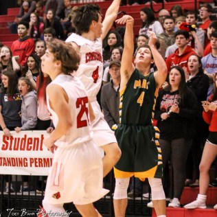 Hoisington Cardinal #4 Mason Haxton tries to block the shot by Pratt Greenback #4 Landen Studer. The Hoisington Cardinals defeated the Pratt Greenbacks by a score of 47 to 41 in the Boys Championship game of the 2018 Hoisington Winter Jam at the Hoisington Activity Center in Hoisington, Kansas on January 20, 2018. (Photo: Joey Bahr, www.joeybahr.com)