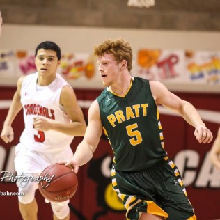 Pratt Greenback #5 Travis Theis dribbles with the ball. The Hoisington Cardinals defeated the Pratt Greenbacks by a score of 47 to 41 in the Boys Championship game of the 2018 Hoisington Winter Jam at the Hoisington Activity Center in Hoisington, Kansas on January 20, 2018. (Photo: Joey Bahr, www.joeybahr.com)