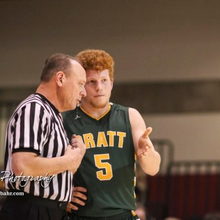 Pratt Greenback #5 Travis Theis discusses the previous call with an official. The Hoisington Cardinals defeated the Pratt Greenbacks by a score of 47 to 41 in the Boys Championship game of the 2018 Hoisington Winter Jam at the Hoisington Activity Center in Hoisington, Kansas on January 20, 2018. (Photo: Joey Bahr, www.joeybahr.com)