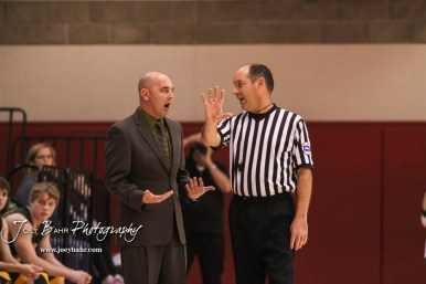 Pratt Greenback Head Coach Chris Battin talks to an official about the previous call. The Hoisington Cardinals defeated the Pratt Greenbacks by a score of 47 to 41 in the Boys Championship game of the 2018 Hoisington Winter Jam at the Hoisington Activity Center in Hoisington, Kansas on January 20, 2018. (Photo: Joey Bahr, www.joeybahr.com)