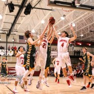 Hoisington Cardinals #4 Mason Haxton and #21 Isaac Prosser reach for a rebound. The Hoisington Cardinals defeated the Pratt Greenbacks by a score of 47 to 41 in the Boys Championship game of the 2018 Hoisington Winter Jam at the Hoisington Activity Center in Hoisington, Kansas on January 20, 2018. (Photo: Joey Bahr, www.joeybahr.com)