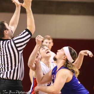 Ellinwood Eagle #2 David Hammeke and Russell Bronco #32 Brooks Nichols coil to jump for the opening tip off. The Russell Broncos defeated the Ellinwood Eagles by a score of 60 to 17 in the Consolation Semi-Final of the 2018 Hoisington Winter Jam at the Hoisington Activity Center in Hoisington, Kansas on January 18, 2018. (Photo: Joey Bahr, www.joeybahr.com)