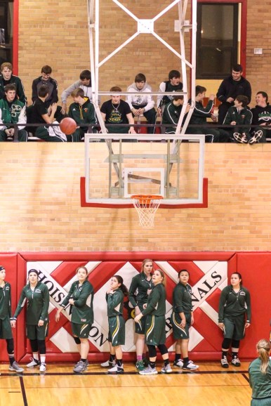 The Pratt Boys Basketball team watches from the stands as the Pratt Lady Greenbacks warmup. The Russell Lady Broncos faced the Pratt Lady Greenbacks in the First Round of the 2018 Hoisington Winter Jam at the Hoisington High School in Hoisington, Kansas on January 16, 2018. (Photo: Joey Bahr, www.joeybahr.com)