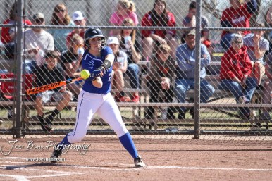 Halstead Lady Dragon Madyson Beckett (#20) swings at a pitch in the top of the second inning. The Hoisington Lady Cardinals defeated the Halstead Lady Dragons by a score of 12 to 2 in six innings at Logan Field in Hoisington, Kansas on April 27, 2018. (Photo: Joey Bahr, www.joeybahr.com)