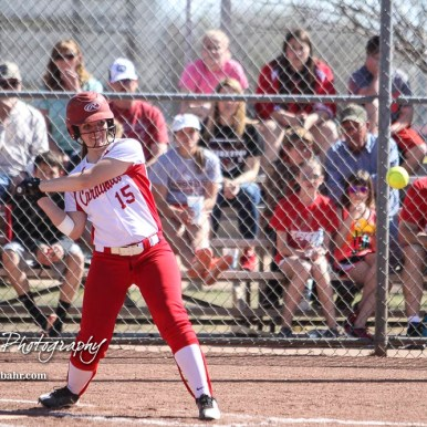 Hoisington Lady Cardinal Brooke Steinert (#15) watches a pitch approaching the plate in the bottom of the second inning. The Hoisington Lady Cardinals defeated the Halstead Lady Dragons by a score of 12 to 2 in six innings at Logan Field in Hoisington, Kansas on April 27, 2018. (Photo: Joey Bahr, www.joeybahr.com)