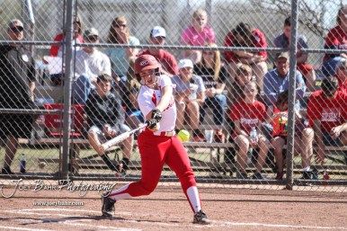 Hoisington Lady Cardinal Bailee Bachar (#8) swings at a pitch in the bottom of the second inning. The Hoisington Lady Cardinals defeated the Halstead Lady Dragons by a score of 12 to 2 in six innings at Logan Field in Hoisington, Kansas on April 27, 2018. (Photo: Joey Bahr, www.joeybahr.com)