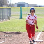 Hoisington Lady Cardinal Trinity Dolezal (#33) gets a lead off from third base in the bottom of the third inning. The Hoisington Lady Cardinals defeated the Halstead Lady Dragons by a score of 12 to 2 in six innings at Logan Field in Hoisington, Kansas on April 27, 2018. (Photo: Joey Bahr, www.joeybahr.com)