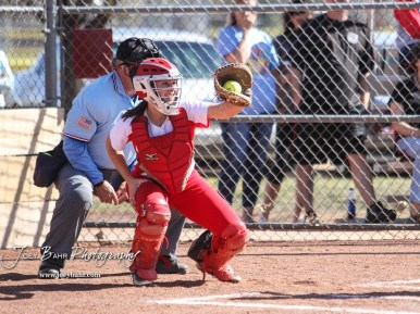 Hoisington Lady Cardinal Trinity Dolezal (#33) catches a pitch in the top of the fourth inning. The Hoisington Lady Cardinals defeated the Halstead Lady Dragons by a score of 12 to 2 in six innings at Logan Field in Hoisington, Kansas on April 27, 2018. (Photo: Joey Bahr, www.joeybahr.com)
