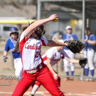 Hoisington Lady Cardinal Taylor Boxberger (#24) winds up a pitch in the top of the fifth inning. The Hoisington Lady Cardinals defeated the Halstead Lady Dragons by a score of 12 to 2 in six innings at Logan Field in Hoisington, Kansas on April 27, 2018. (Photo: Joey Bahr, www.joeybahr.com)