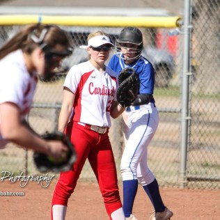 Halstead Lady Dragon Callie Considine (#0) watches the pitcher in order to get a lead off in the top of the fifth inning. The Hoisington Lady Cardinals defeated the Halstead Lady Dragons by a score of 12 to 2 in six innings at Logan Field in Hoisington, Kansas on April 27, 2018. (Photo: Joey Bahr, www.joeybahr.com)