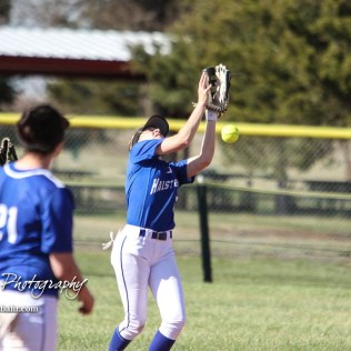 A ball bounces off the glove of Halstead Lady Dragon Cara Weber (#5) in the bottom of the fifth inning. The Hoisington Lady Cardinals defeated the Halstead Lady Dragons by a score of 12 to 2 in six innings at Logan Field in Hoisington, Kansas on April 27, 2018. (Photo: Joey Bahr, www.joeybahr.com)