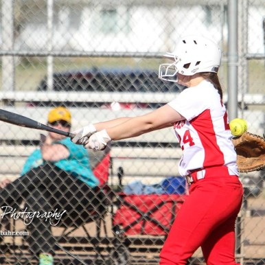 Hoisington Lady Cardinal Taylor Boxberger (#24) swings at a pitch in the bottom of the sixth inning. The Hoisington Lady Cardinals defeated the Halstead Lady Dragons by a score of 12 to 2 in six innings at Logan Field in Hoisington, Kansas on April 27, 2018. (Photo: Joey Bahr, www.joeybahr.com)