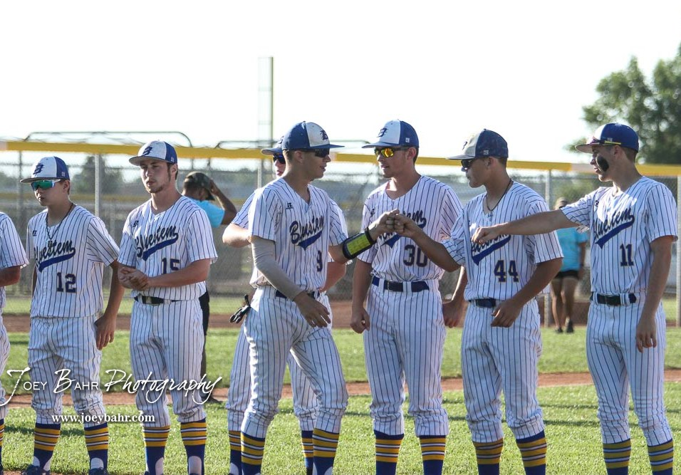 Bluestem Lion #9 Nicholas Laidler greets teammates during the introduction of players prior to the start of the game. The Spearville Royal Lancers defeated the Bluestem Lions 5 to 1 in the KSHSAA Class 2-1A State Baseball Quarterfinal at the Great Bend Sports Complex in Great Bend, Kansas on May 24, 2018. (Photo: Joey Bahr, www.joeybahr.com)