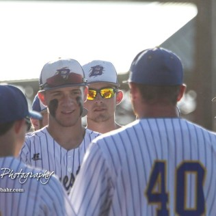 The Bluestem Lions huddle up around Head Coach Grant Bachura before the start of the game. The Spearville Royal Lancers defeated the Bluestem Lions 5 to 1 in the KSHSAA Class 2-1A State Baseball Quarterfinal at the Great Bend Sports Complex in Great Bend, Kansas on May 24, 2018. (Photo: Joey Bahr, www.joeybahr.com)