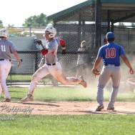Chase County Bulldog #6 Ryan Kohr crosses home plate to score a run in the top of the fifth inning. The Chase County Bulldogs defeated the West Elk Patriots 16 to 5 in the KSHSAA Class 2-1A State Baseball Quarterfinal at the Great Bend Sports Complex in Great Bend, Kansas on May 24, 2018. (Photo: Joey Bahr, www.joeybahr.com)