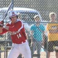 Hoisington Cardinal Braxton Donovan (#14) watches a pitch approach the plate in the bottom of the first inning. The Hoisington Cardinals defeated the Halstead Dragons by a score of 10 to 6 at Legion Field in Hoisington, Kansas on April 27, 2018. (Photo: Joey Bahr, www.joeybahr.com)