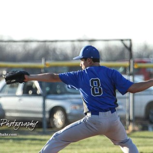Halstead Dragon Ivan Gutierrez (#8) winds up for a pitch in the bottom of the second inning. The Hoisington Cardinals defeated the Halstead Dragons by a score of 10 to 6 at Legion Field in Hoisington, Kansas on April 27, 2018. (Photo: Joey Bahr, www.joeybahr.com)