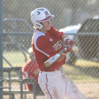 Hoisington Cardinal Myles Menges (#4) swings at a pitch in the bottom of the second inning. The Hoisington Cardinals defeated the Halstead Dragons by a score of 10 to 6 at Legion Field in Hoisington, Kansas on April 27, 2018. (Photo: Joey Bahr, www.joeybahr.com)