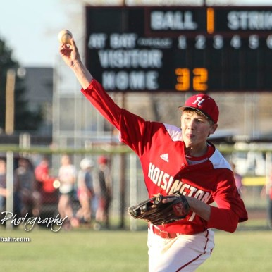 Hoisington Cardinal Isaac Prosser (#21) throws a pitch in the top of the third inning. The Hoisington Cardinals defeated the Halstead Dragons by a score of 10 to 6 at Legion Field in Hoisington, Kansas on April 27, 2018. (Photo: Joey Bahr, www.joeybahr.com)