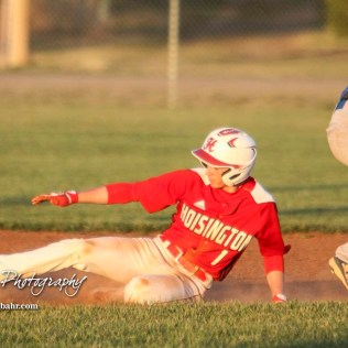 Hoisington Cardinal Trey Byers (#1) slides into second to steal the base in the bottom of the fourth inning. The Hoisington Cardinals defeated the Halstead Dragons by a score of 10 to 6 at Legion Field in Hoisington, Kansas on April 27, 2018. (Photo: Joey Bahr, www.joeybahr.com)