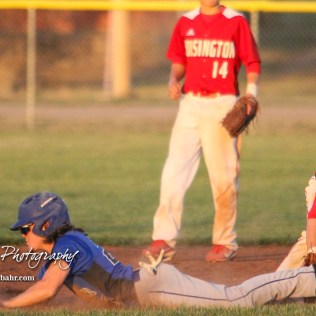 Halstead Dragon Bryant Odendahl (#23) slides into second base and beats the tag to steal the base in the top of the fifth inning. The Hoisington Cardinals defeated the Halstead Dragons by a score of 10 to 6 at Legion Field in Hoisington, Kansas on April 27, 2018. (Photo: Joey Bahr, www.joeybahr.com)