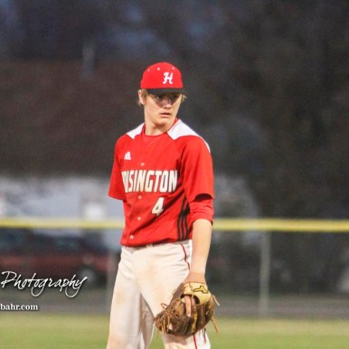 Hoisington Cardinal Myles Menges (#4) looks for the pitch selection from his catcher in the top of the sixth inning. The Hoisington Cardinals defeated the Halstead Dragons by a score of 10 to 6 at Legion Field in Hoisington, Kansas on April 27, 2018. (Photo: Joey Bahr, www.joeybahr.com)