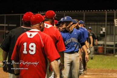 Members of the Halstead Dragons and Hoisington Cardinals shake hands after the end of the game. The Hoisington Cardinals defeated the Halstead Dragons by a score of 10 to 6 at Legion Field in Hoisington, Kansas on April 27, 2018. (Photo: Joey Bahr, www.joeybahr.com)