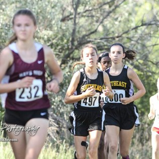 Eleanor Been (#497) of Wichita Southeast runs up a long incline. The Great Bend Cross Country Invitational was held at Lake Barton near Great Bend, Kansas on August 30, 2018. (Photo: Joey Bahr, www.joeybahr.com)