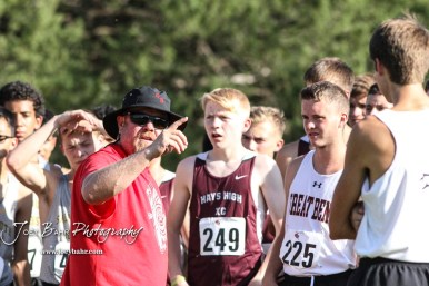 Great Bend coach Lyles Lashley explains the course to the competitors before the start of the boys varsity race. The Great Bend Cross Country Invitational was held at Lake Barton near Great Bend, Kansas on August 30, 2018. (Photo: Joey Bahr, www.joeybahr.com)