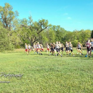 Competitors take off from the starting line in the boys varsity race. The Great Bend Cross Country Invitational was held at Lake Barton near Great Bend, Kansas on August 30, 2018. (Photo: Joey Bahr, www.joeybahr.com)