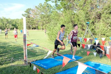 Landon Viegra (#265) of Hays beats Noe Rodriguez-Jimenez (#170) of Garden City to the line for thirty-fourth place. The Great Bend Cross Country Invitational was held at Lake Barton near Great Bend, Kansas on August 30, 2018. (Photo: Joey Bahr, www.joeybahr.com)