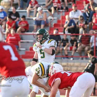 Pratt Greenback #5 Travis Theis looks to the sideline for the next play to run in the first quarter. The Pratt Greenbacks defeated the Hoisington Cardinals by a score of 34 to 0 at Elton Brown Field in Hoisington, Kansas on August 31, 2018. (Photo: Joey Bahr, www.joeybahr.com)