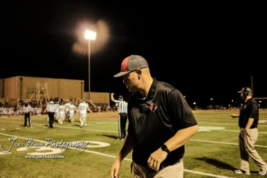 Hoisington Cardinal Head Coach Zach Baird thinks of the next play to run in the fourth quarter. The Pratt Greenbacks defeated the Hoisington Cardinals by a score of 34 to 0 at Elton Brown Field in Hoisington, Kansas on August 31, 2018. (Photo: Joey Bahr, www.joeybahr.com)