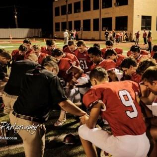 The Hoisington Cardinals pray after the end of the game. The Pratt Greenbacks defeated the Hoisington Cardinals by a score of 34 to 0 at Elton Brown Field in Hoisington, Kansas on August 31, 2018. (Photo: Joey Bahr, www.joeybahr.com)