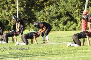 The Little River Redskins stretch prior to the start of the game. The Central Plains Oilers defeated the Little River Redskins by a score of 46 to 0 at Community Memorial Park in Little River, Kansas on September 21, 2018. (Photo: Joey Bahr, www.joeybahr.com)