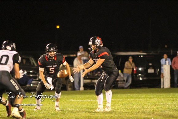 Little River Redskin #3 Graham Stephens holds his hands out for a snap as #5 Matt Dougherty starts to move down the line in the third quarter. The Central Plains Oilers defeated the Little River Redskins by a score of 46 to 0 at Community Memorial Park in Little River, Kansas on September 21, 2018. (Photo: Joey Bahr, www.joeybahr.com)