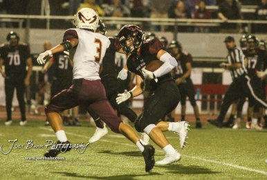 Great Bend Panther #16 Dalton Miller moves to avoid Hays Indian #3 Taivian Creamer in the third quarter. The Great Bend Panthers defeated the Hays Indians with a score of 15 to 7 at Memorial Stadium in Great Bend, Kansas on September 7, 2018. (Photo: Joey Bahr, www.joeybahr.com)