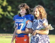 Sophomore attendants Bryce Frazier and Danica Bartonek stand during Homecoming festivities. The Stafford Trojans faced the Otis-Bison Cougars at Cougar Field in Otis, Kansas on September 14, 2018. (Photo: Joey Bahr, www.joeybahr.com)