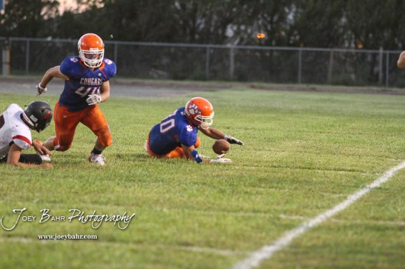 Otis-Bison Cougar #80 Seth Hoopingarner jumps on a loose ball to cause a turnover. The Stafford Trojans faced the Otis-Bison Cougars at Cougar Field in Otis, Kansas on September 14, 2018. (Photo: Joey Bahr, www.joeybahr.com)