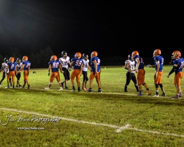 Members of the Stafford Trojans and Otis-Bison Cougars shake hands following the game. The Otis-Bison Cougars defeated the Stafford Trojans by a score of 50 to 0 at Cougar Field in Otis, Kansas on September 14, 2018. (Photo: Joey Bahr, www.joeybahr.com)