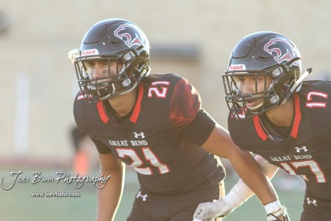 Great Bend Panthers #21 David Garcia and #17 Alex Olivas take part in a pregame warmup. The Great Bend Panthers defeated the Garden City Buffaloes 49 to 6 at Memorial Stadium in Great Bend, Kansas on October 19, 2018. (Photo: Joey Bahr, www.joeybahr.com)