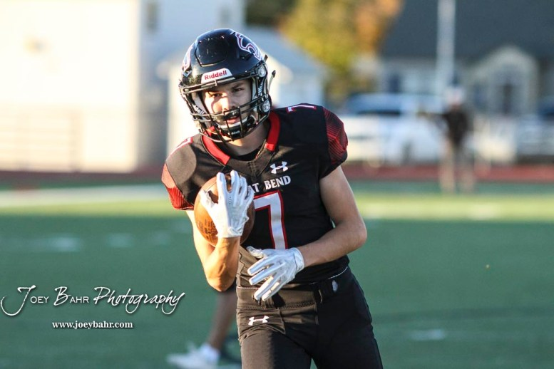 Great Bend Panther #7 Calan Haberman pulls in the ball during pregame warmups. The Great Bend Panthers defeated the Garden City Buffaloes 49 to 6 at Memorial Stadium in Great Bend, Kansas on October 19, 2018. (Photo: Joey Bahr, www.joeybahr.com)